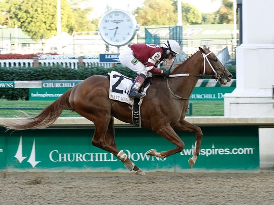 In a photo provided by Churchill Downs, Tapiture, ridden by Rosie Napravnik, wins the Matt Winn horse race Saturday, June 14, 2014, at Churchill Downs in Louisville, Ky. (AP Photo/Churchill Downs/Reed Palmer Photography)