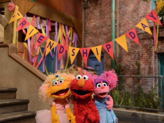 sesame street updates set and joins hbo