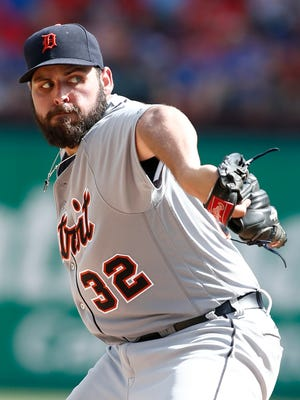 Detroit Tigers starting pitcher Michael Fulmer pitches against the Texas Rangers in the ninth inning of a baseball game Sunday, Aug. 14, 2016, in Arlington, Texas.