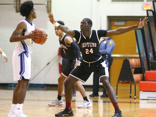 Jared Kimbrough defends against Ewing Twp. during boys
