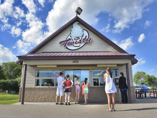 Customers line up outside Mr. Twisty Thursday in St. Cloud.