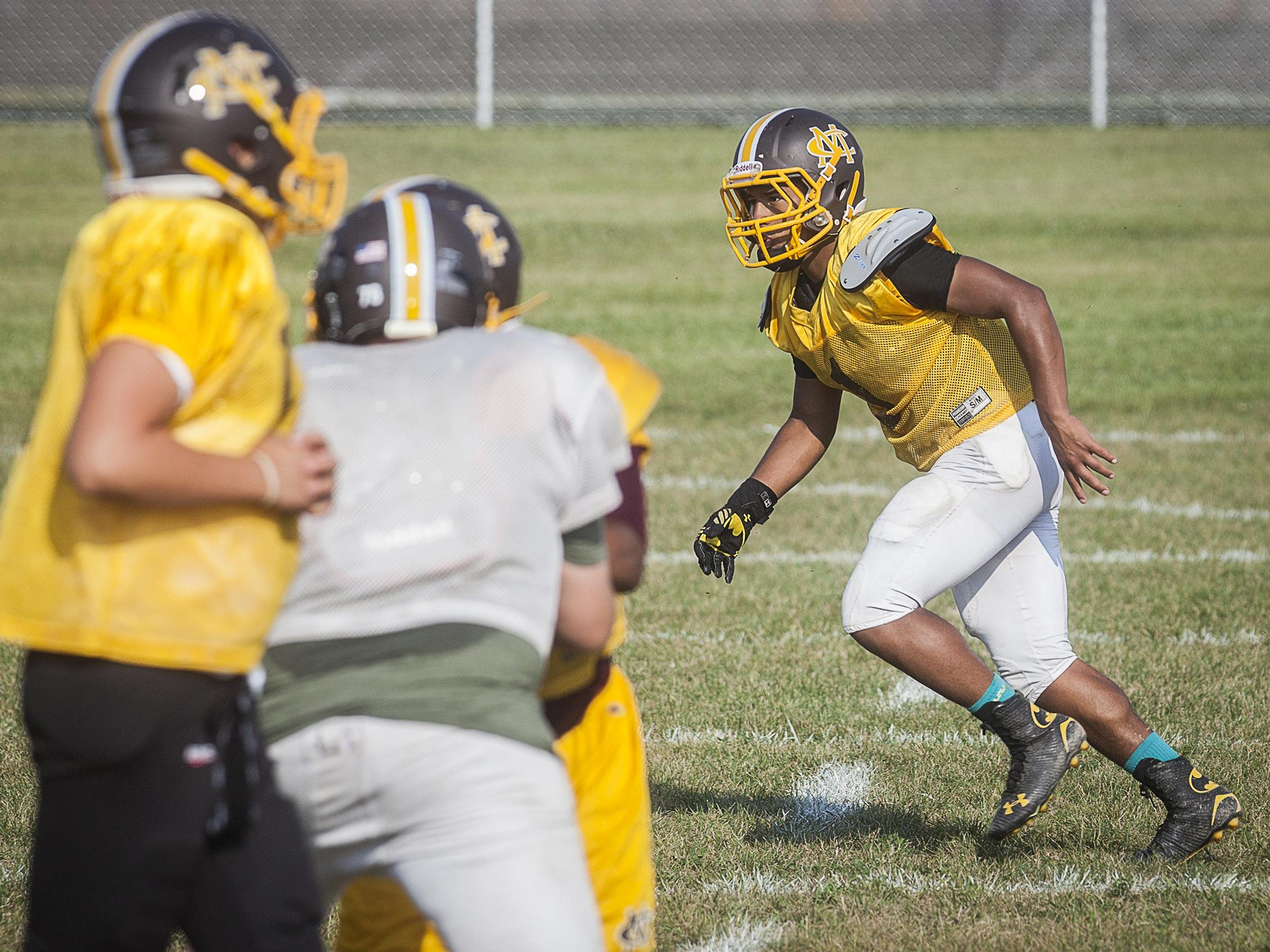Monroe Central's Tyler Writtenhouse practices with teammates at Monroe Central High School Tuesday.
