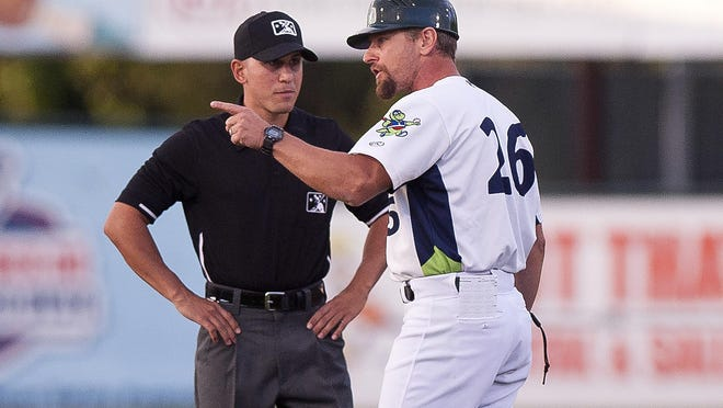 Vermont Lake Monsters manager Aaron Nieckula, right, talks to the second base umpire during a break in the action against the Brooklyn Cyclones on Wednesday night at Centennial Field.