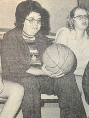 Louise Drummond holds a basketball during an Adena girls basketball practice in this photo from March 1976.