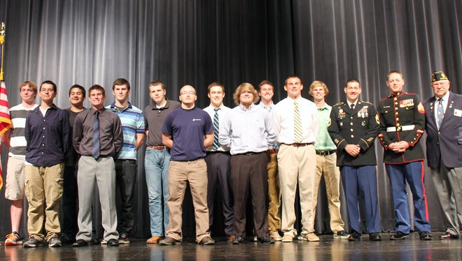 Mason High School honored 14 military-bound students at a ceremony on Wednesday, May 21, 2014.  Pictured are:  (back row) Greg Penland, Kyle McDonald, Spencer Ware, Conner Timson, Will Chappell, Noah Grollmus (front row) Jacob Cervantes, Cameron Elliot, Maverick Roberts, Joey Steur, Matt Stewart, SFC Velazco, SGT Weldon, John Looker, American Legion. (Jennifer Giang and Hunter Burkhart not pictured)