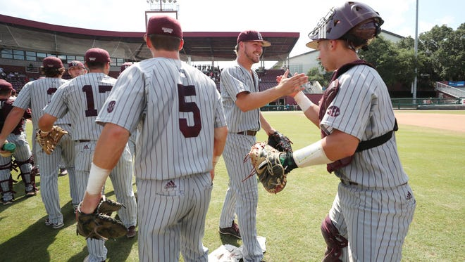 Mississippi State's Riley Self, center, and Dustin Skelton, right, celebrate after the Bulldogs beat Oklahoma.