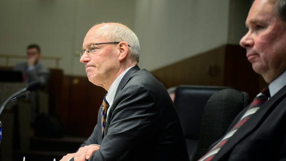 Minnesota Management and Budget Commissioner Myron Frans faces tough questioning at the House Ways and Means Committee hearing about Governor Dayton's raises for commissioners, Monday, Feb. 9, 2015 at the statehouse in St. Paul. as Chairman Jim Knoblach looks on. (AP Photo/Star Tribune, Glen Stubbe)