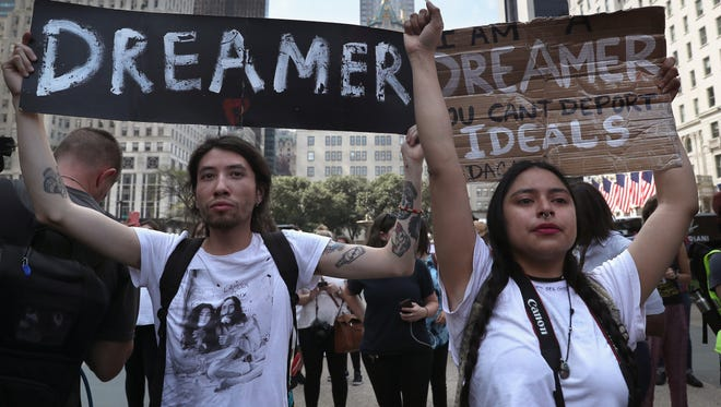DREAMers Jovan Rodrigo, 27, and Gloria Mendoza, 26, take part in a protest near Trump Tower on September 5, 2017, in New York City. Both Rodrigo and Mendoza said they were brought to the United States from Mexico when they were children. The Trump administration announced it is ending the Obama-era DACA program that shields young undocumented immigrants from deportation.