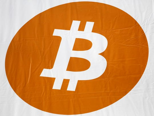 A bitcoin logo is displayed at the Inside Bitcoins