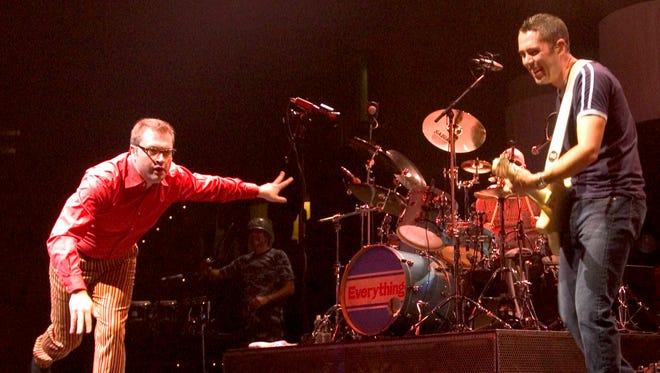 The rock group Barenaked Ladies performs March 2, 2004, at the Fleet Center in Boston. From left, lead vocalist Steven Page, drummer Tyler Stewart and guitarist and vocalist Ed Robertson.
