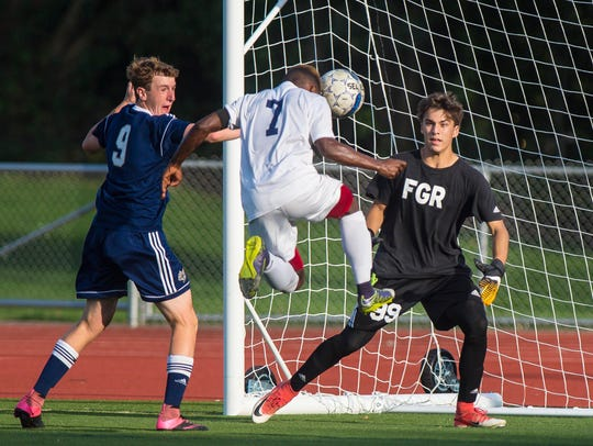 Essex goalie Gordon Schmalz, right, and defender Nolan Davis, left, are part of a large senior class for the Hornets boys soccer team.