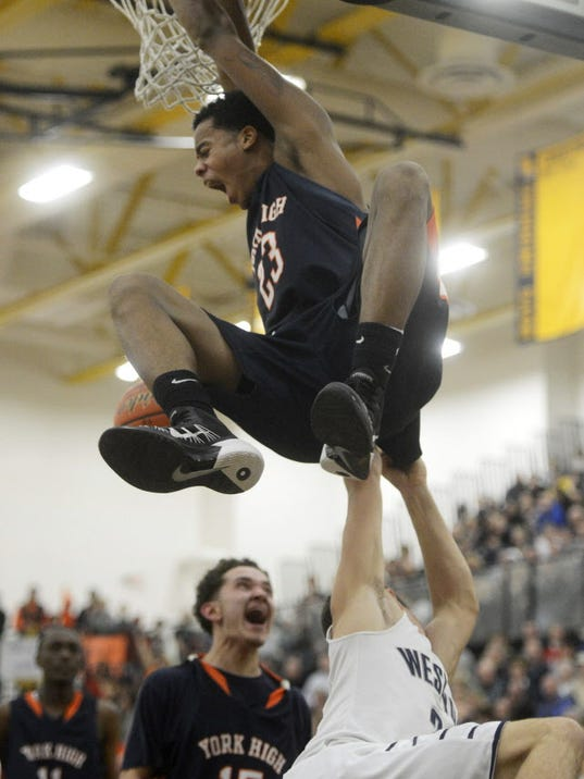 A dunk by William Penn's Jahaire Wilson during last season's YAIAA tournament semifinals propelled the Bearcats into the finals. They went on to lose to Central York but rebounded for a District 3 Class AAAA title as a No. 8 seed. Wilson returns along with junior guard Trey Shifflett, who looks on below.  (FILE -- GAMETIMEPA.COM)