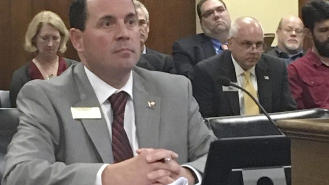 Arkansas state Rep. Andy Mayberry waits as the House Public Health, Welfare and Labor Committee votes on his proposal to restrict dilation and evacuation abortions Thursday at the State Capitol in Little Rock.