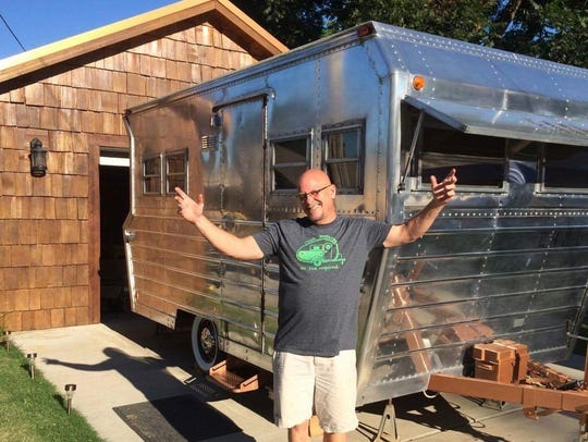Steve Folsom poses with Earl the camper. Earl was once