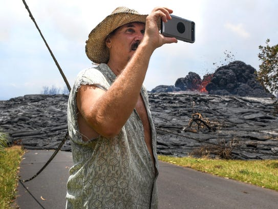 Will Devine takes snapshots of a lava flow in the Leilani