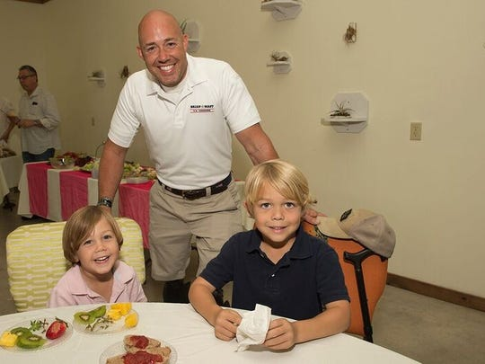 U.S. Congressman Brian Mast, with sons Mavrick and Magnum, attends the 2016 Spring Forward for Hunger Event.