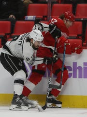 Red Wings forward David Booth is checked by the Kings'