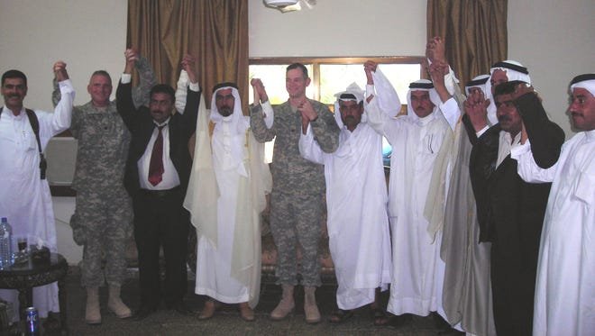 Then-Col. Sean MacFarland. center,  met with tribal leaders in Ramadi in 2006 to form an alliance.