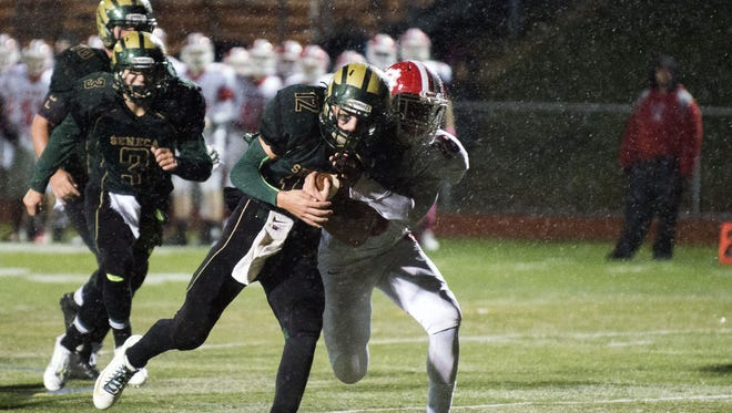 Seneca's JJ Scarpello carries the ball into the end zone in a game against Friday night at Cherokee High School.
