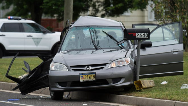 The aftermath of a collision involving a Honda Civic and a Nissan SUV is seen at the intersection of Maple Avenue and Brewster Road in Vineland on June 3.