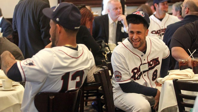 The Somerset Patriots hold a luncheon at Maggiano's in Bridgewater to introduce the 2015 baseball team. Players Robert Andino, left, and David Vidal, right, sit with supporters of the team.