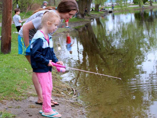 A young angler watches her line during the April 29 Trout Unlimited youth fishing derby at Eldridge Lake in Elmira.