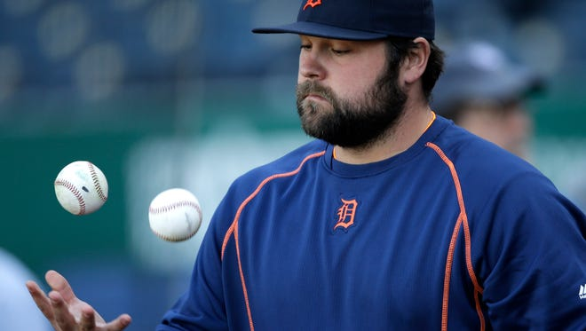 Joba Chamberlain juggles before Thursday night's game against the Royals.