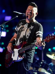Jay DeMarcus, of Rascal Flatts, performs onstage during