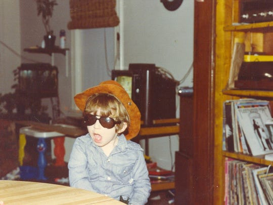 Adam Worth as a child with his parent's record collection.