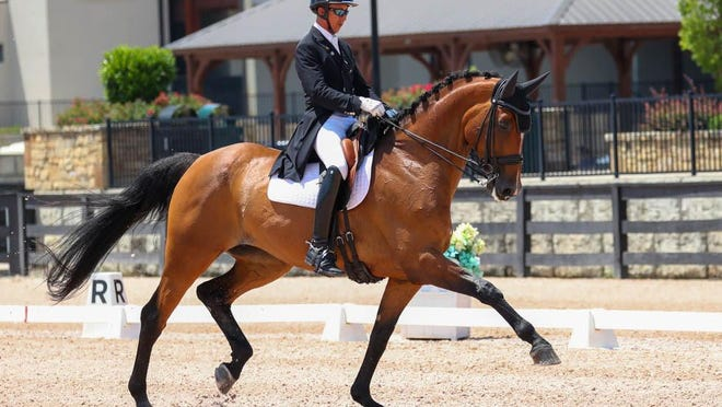 Julio Mendoza Loor and Rosali participate in the dressage competition at Tryon International Equestrian Center.