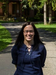 Julie Mayle, associate curator of manuscripts at the