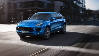 The 2015 Porsche Macan compact SUV is a highly modified and Porsche-ized Audi Q5. It starts at about $50,000.