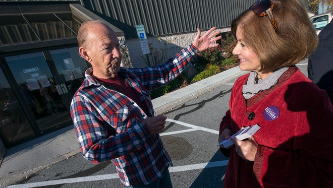 Lewis Hauk, left talks with Susan Byrnes at the Dover Township polling place No. 1 on Election Day. Byrnes, a challenger, ended up with the most votes of anyone running for county commissioner, and will join two incumbents on the board.