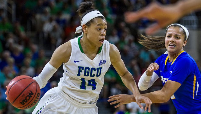 FGCU's Whitney Knight drives past a Hofstra defender Monday evening at Alico Areno as part of the Women's NIT quarter finals round.