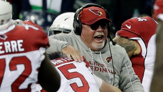 York High graduate Bruce Arians is seen here celebrating during his tenure as head coach of the Arizona Cardinals. Arians, who is now a football analyst for CBS, said the only coaching job he would now consider is with the Cleveland Browns. AP FILE PHOTO