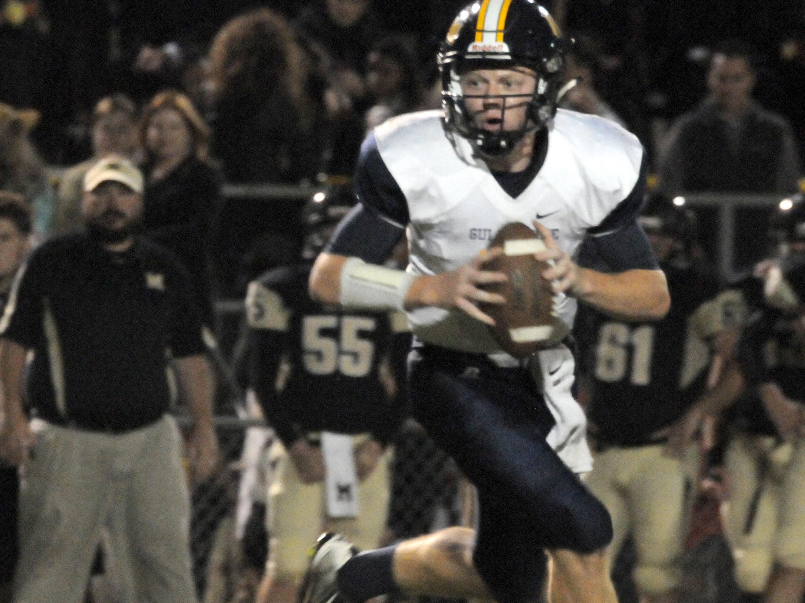 Gulf Breeze quarterback Tyler Phelps threw for 273 yards and five touchdowns as the Dolphins defeated the Milton Panthers 48-26 at Hurley Manning Field to spoil the Panthers' homecoming festivities.