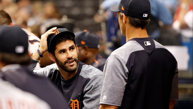 Tigers rightfielder J.D. Martinez talks with manager Brad Ausmus in the dugout April 18, 2017 in St. Petersburg, Fla.