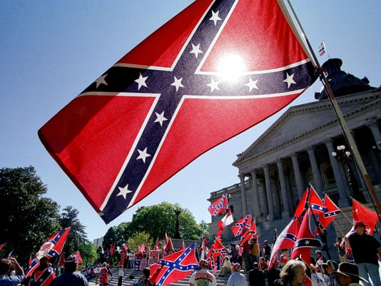 Confederate flag supporters demonstrate on the nor