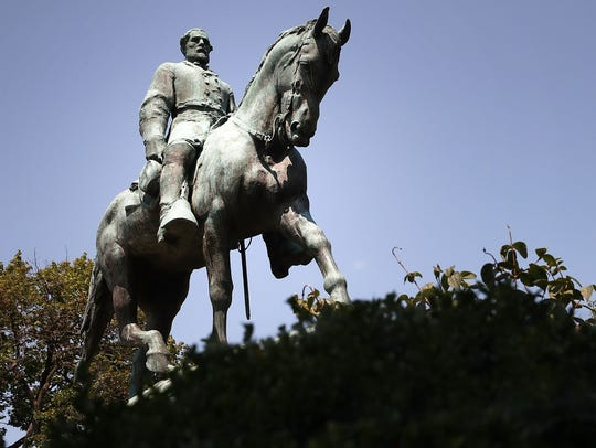 The statue of Confederate Gen. Robert E. Lee stands
