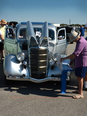 Carol Wynn admires a 1935 Ford Humpback at the Fly-In Cruise-In event.
