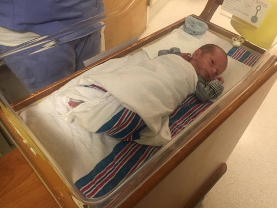 Chase Guerra lies in a bassinet in the hospital. He