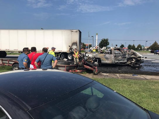 A tractor-trailer and three other vehicles collided