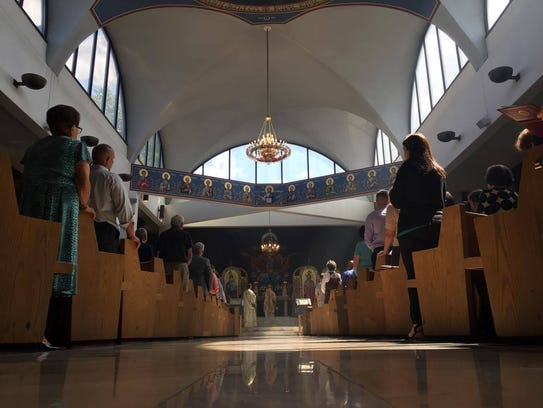 Parishioners watch the service Sunday morning. It lasted
