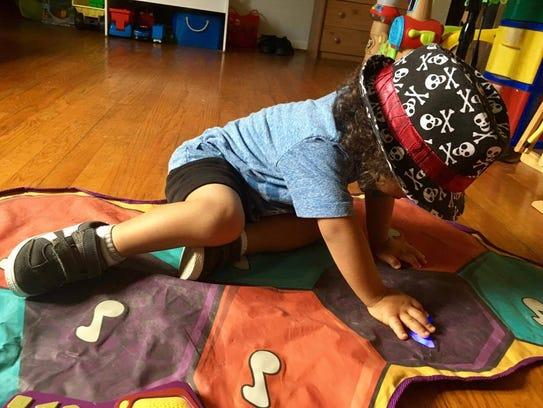 Keyanni Webber, 4, plays with his toys at his Waynesboro