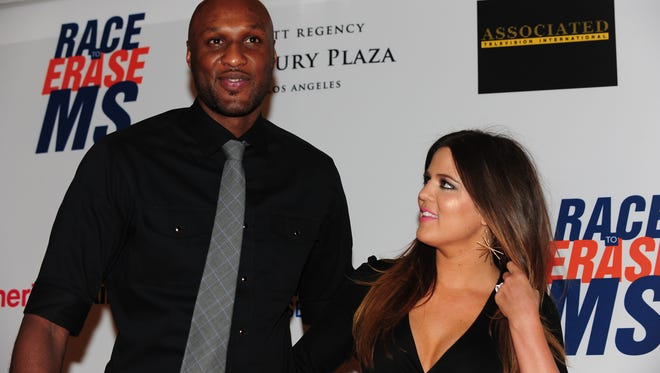 "Lamar Odom and Khloe Kardashian-Odom pose on arrival for the 19th Annual Race to Erase MS themed ""Glam Rock to Erase MS"" in Los Angeles on May 18, 2012."