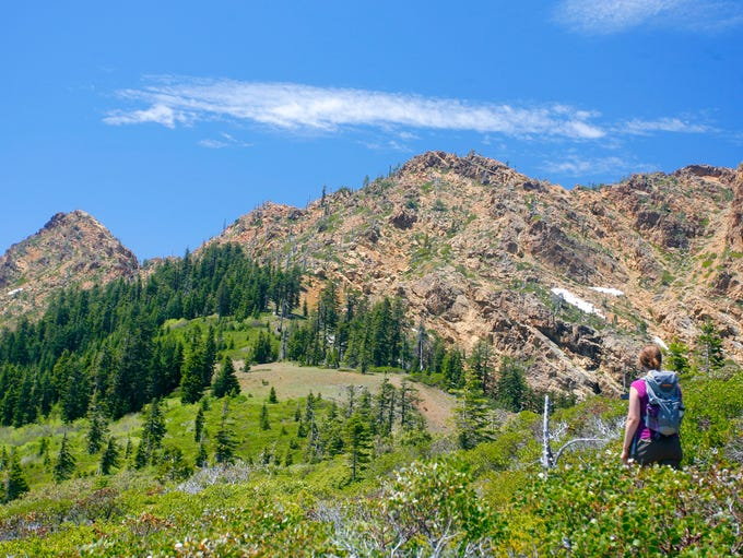 Hiking past the base of the Red Buttes.