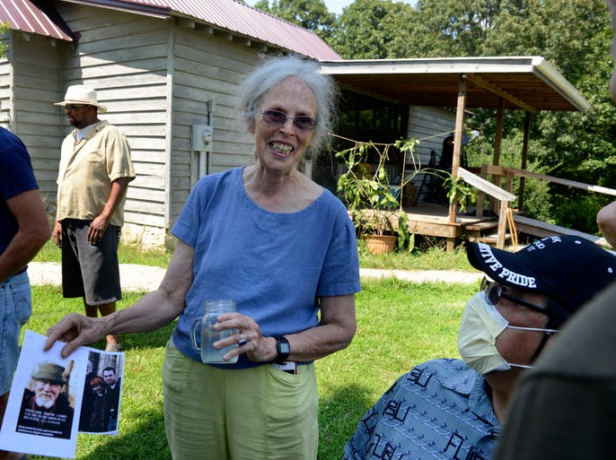 Ina May Gaskin holds a photograph of her husband, The Farm founder Stephen Gaskin, at a wake for him at their home in Summertown, Tenn., on Sunday, July 6, 2014.