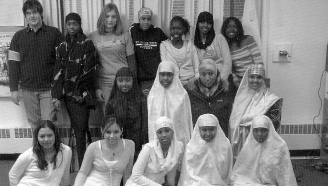 C.A.R.E., or Cultural Awareness and Racial Equity club, gave students a chance to explore different cultures. Pictured in the 2006 Techoes are, from left, back, Zach Steele, Amal Hassan, Emily Hommerding, Nasra Hassan, Arriat Odol, Amal Farah and Karapari Odol; middle, Iqro Hussein, Zamzam Salad, Amina Mohamed and Fadumo Omar; first row, Nayeli Mendez, Elizabeth Tamez, Luul Abdi, Farhiya Iman and Fardowsa Salad.