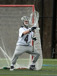Webster Thomas goalie Ethan Ruller gets a close look