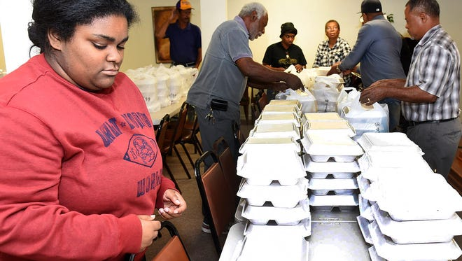 Thanksgiving dinners prepared by volunteers from Community Outreach in Opelousas.